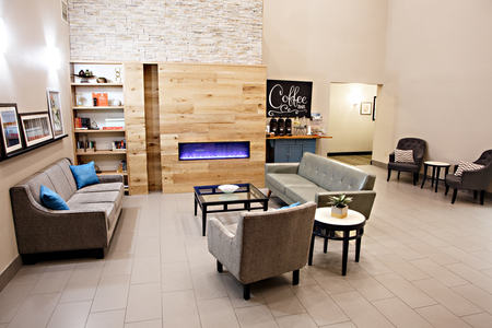 Hotel lobby with a modern fireplace and coffee station
