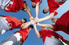Members of a sports team in a huddle