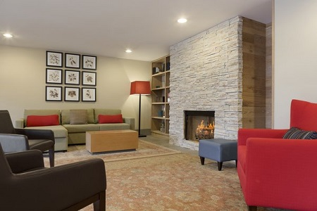 Lobby with stone fireplace and colorful seating