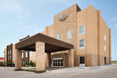 Katy hotel exterior with sand-colored stone | Country Inn & Suites