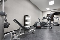 Fitness center with cardio equipment and fresh towels