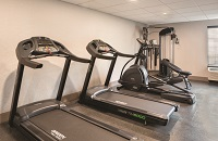 Fitness center with two treadmills, an elliptical and a weights machine