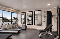 On-site fitness center with a multi-gym, two treadmills and an elliptical