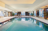 Sparkling indoor pool with recessed ceiling in Racine, WI