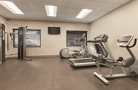 Fitness center with a multi gym, a treadmill, an elliptical and a recumbent bike