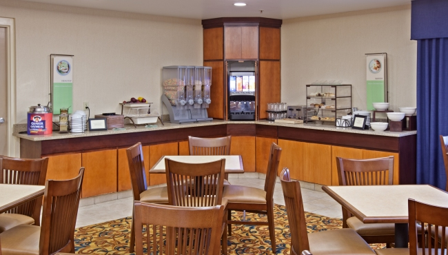 Hotel's breakfast room with hot and cold food options