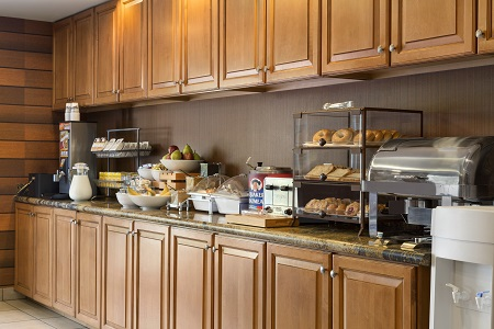 Hotel's free, hot breakfast includes assorted breads and fresh fruit