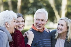 Seniors enjoying their family with children and grandchildren