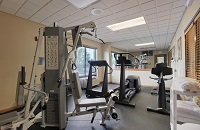 Fitness center with treadmill, Total Gym and more