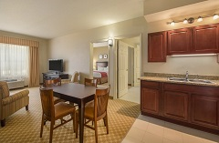 Suite living room with a dining area and a kitchenette