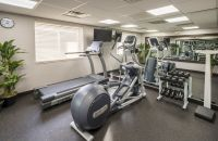 Fitness center with treadmill, elliptical and weights