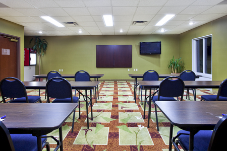 Meeting room with tables and chairs in a classroom-style setup
