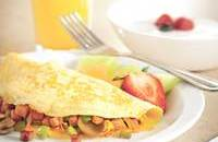 Complimentary, hot breakfast with an omelet and orange juice
