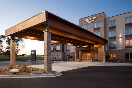 Country Inn & Suites, Roseville, MN hotel entrance with a carport
