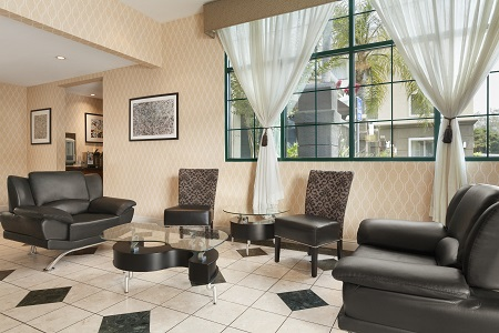 Hotel lobby with black chairs and modern tables