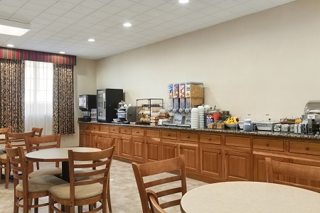 Hotel dining area with cereal, oatmeal and fruit on the breakfast bar