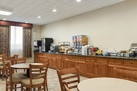Hotel dining area with cereal and oatmeal on the breakfast bar