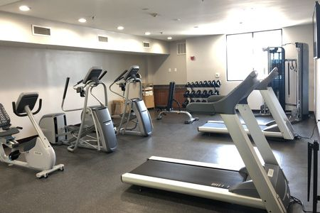 Fitness center with treadmills, ellipticals, a recumbent bike and free weights