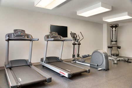 Fitness center with two treadmills, an elliptical and a multi-gym