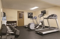 Fitness room with free weights, two treadmills and an elliptical