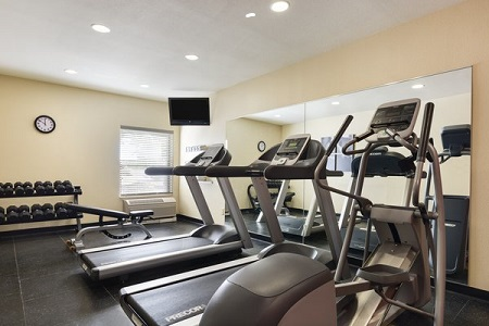 Hotel's fitness center with treadmills