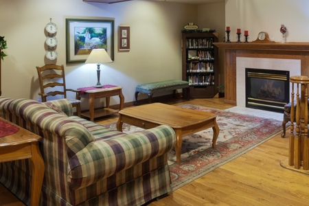 Fireplace and bookshelves in our Valley City hotel's lobby