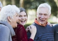 Senior couple laughing with their granddaughter