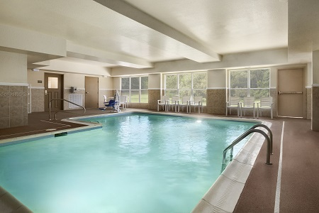 Indoor pool with deck chairs at Doswell hotel