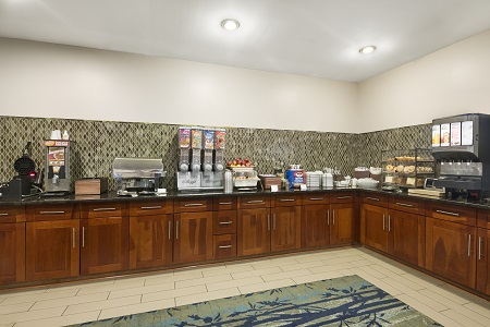 Breakfast area with green tile backsplash