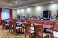Hotel dining area with tables and chairs