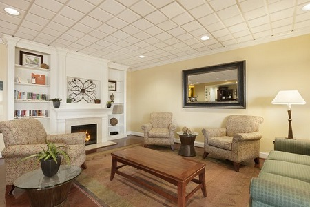 Hotel lobby with seating around a white fireplace
