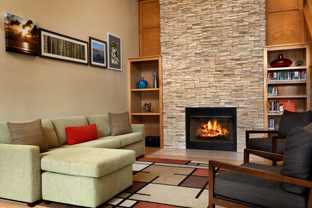 Hotel lobby with a fireplace, bookshelves and comfortable seating