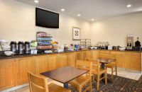 Breakfast area featuring various coffees, cereals and hot meal options