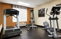 Fitness center with a treadmill, elliptical and weights machine
