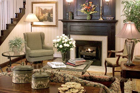 Lobby with chairs and flowers by the fireplace