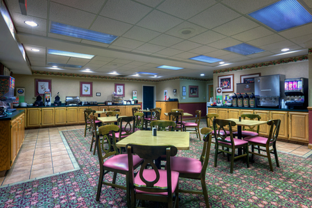 Dining area with breakfast items and ample seating