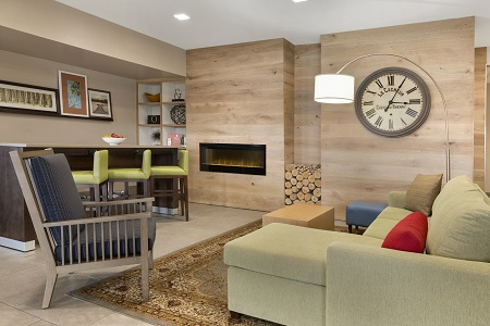 Spacious lobby with fireplace and seating in Richmond