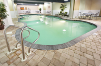 Indoor heated pool surrounded by tile