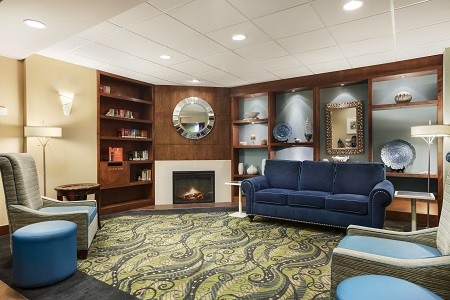 Hotel lobby with fireplace and blue sofa