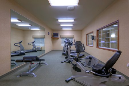 Fitness equipment in front of mirror