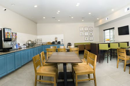 Dining room featuring blue cabinets, hot breakfast options and ample seating
