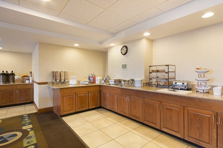 Cereal dispensers, coffee and bagels in the dining area