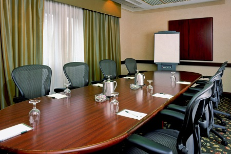 Boardroom with natural lighting and ergonomic chairs