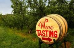 Barrel being used as a sign pointing toward a Wine Tasting
