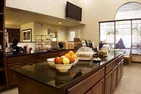 Breakfast area with waffle maker, fresh fruit and flat-screen TV