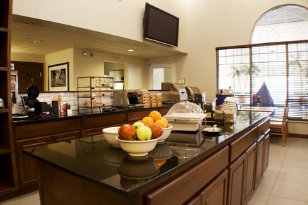 Fresh fruit on counter in hotel's well-lit dining area