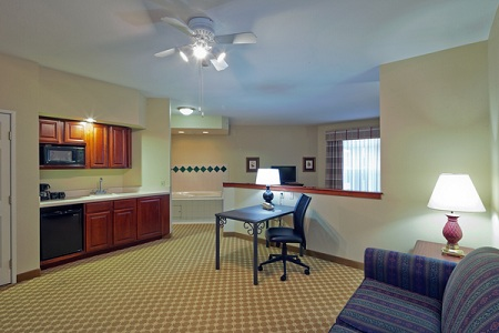Suite with kitchen area, desk and living room