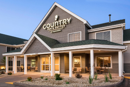 Country Inn & Suites, Chippewa Falls hotel exterior with patio furniture