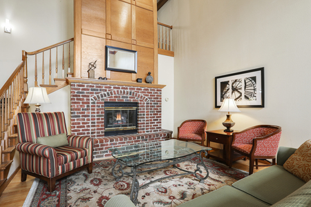 Welcoming hotel lobby with a brick fireplace and plush seating