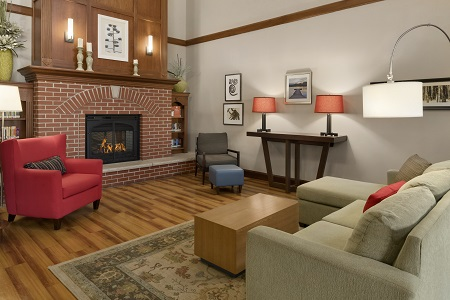 Hotel lobby with fireplace, sofa and armchairs
